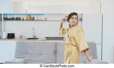 Beautiful girl in bathrobe relaxing at home.Young Woman In Her Morning Routine, After A Shower.Beautiful girl in bathrobe relaxing at home.