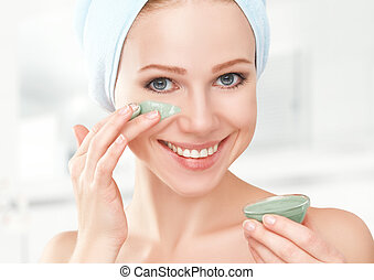 beautiful girl in bathroom and mask for facial skin care