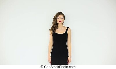 Beautiful girl in black dress on a white background