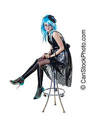 Beautiful girl in black dress sitting on chair