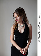 beautiful girl in black evening dress cocktail party