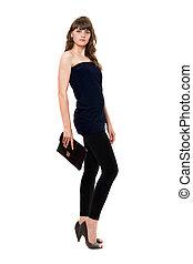 Beautiful girl in black leggings with a handbag