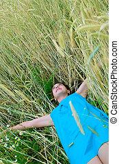 girl in blue dress in field