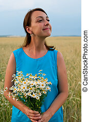 girl in blue dress with chamomiles