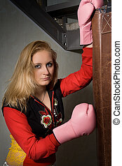 beautiful Girl in boxing gloves.
