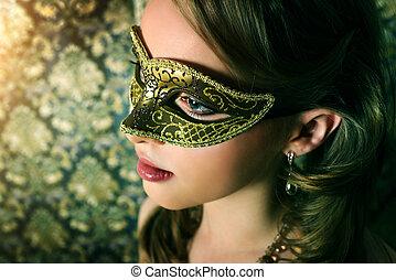 Beautiful girl in carnival mask