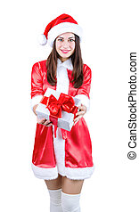 beautiful girl in Christmas dress and cap with a gift