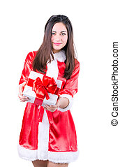 beautiful girl in Christmas dress with a gift