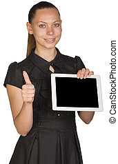 Beautiful girl in dress holding tablet and showing thumb-up
