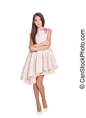 beautiful girl in dress posing isolated