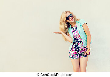 Beautiful girl in fashionable clothes.