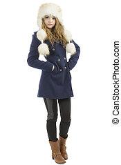 Beautiful Girl in Fur Hat. Winter Woman Portrait