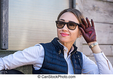 Beautiful girl in gloves with a heart