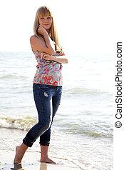 beautiful girl in hat at beach