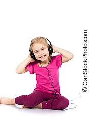 Beautiful girl in headphones listening to the music isolated on white