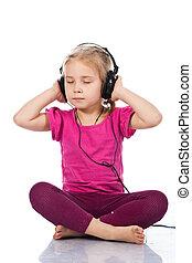 Beautiful girl in headphones listening to the music