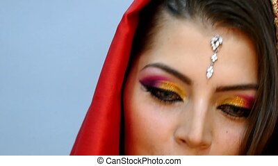 Close up view to Beautiful girl in national Indian dress