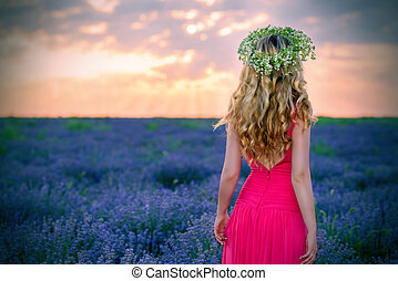 Beautiful Girl in lavender Field at sunset