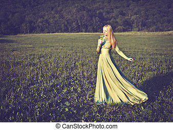 beautiful girl in long green dress with bouquet of flowers...