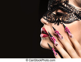 Beautiful girl in mask with long nails and sensual lips. Beauty face.