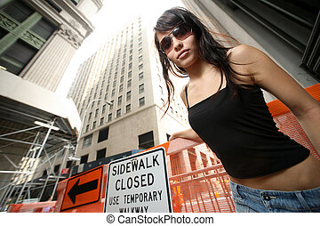 Beautiful girl in New York City. Wide angle view from below.