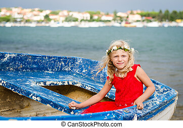 beautiful girl in old boat