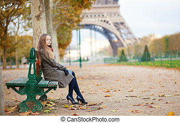 Beautiful girl in Paris on a fall day