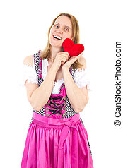 Beautiful girl in pink dirndl happy about upcoming valentines day