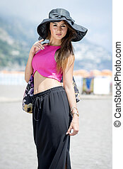 Beautiful girl in Positano on the Amalfi posing in the street with fashion clothes