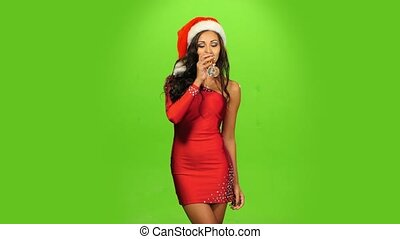 beautiful girl in red dress with glass. New Year Eve. green...