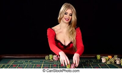 Beautiful girl in red sexy dress won at the casino. Black