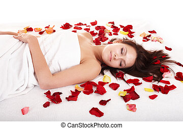 Beautiful girl in rose petal. Beauty parlour. Isolated.