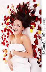 Beautiful girl in rose petal. Isolated.