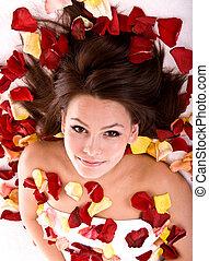 Beautiful girl in rose petal.