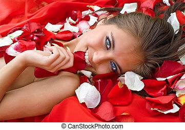 Beautiful girl in rose petal