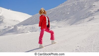 Beautiful Girl in Ski Outfit on the Snow - Beautiful Afro...