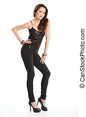 Beautiful girl in skinny jeans - Sexy pose of girl in black ...