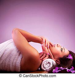 Beautiful girl in spa salon