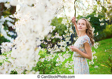 Beautiful girl in spring garden