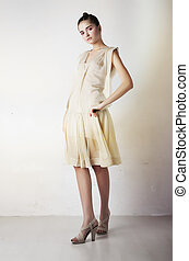 Beautiful girl in stylish fashion clothing standing