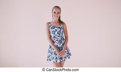 beautiful girl in summer dress posing on a white background