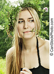 beautiful girl in summer forest