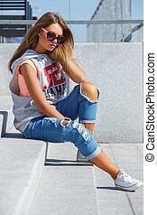 Beautiful girl in sunglasses - Outdoor, street. Attractive...