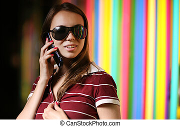 Beautiful girl in sunglasses talkng on cell phone