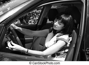 Beautiful girl in the automobile