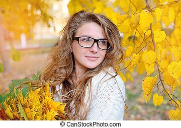 beautiful girl in the autumn