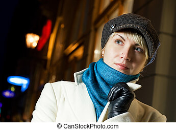 Beautiful girl in the city at night time