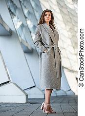 Beautiful girl in the coat