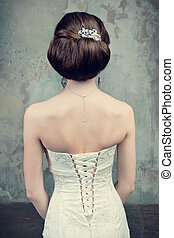 beautiful girl in the dress of the bride from the back on the st