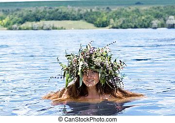Beautiful girl in the lake
